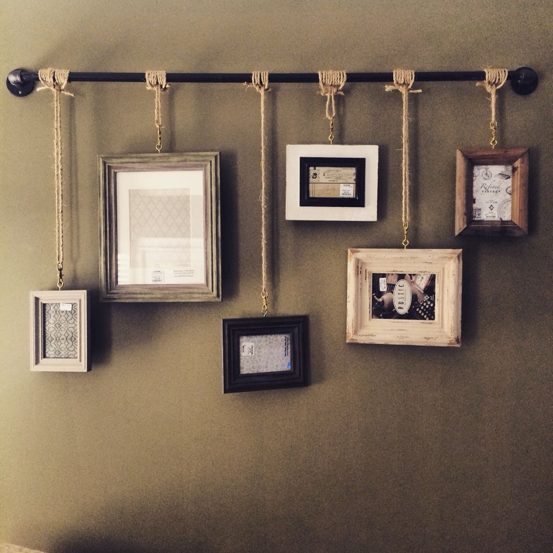 Hanging Wall Pictures Using Black Pipe And Rope Prusic Knot Quick Release Clips To Change Frames Or Photos