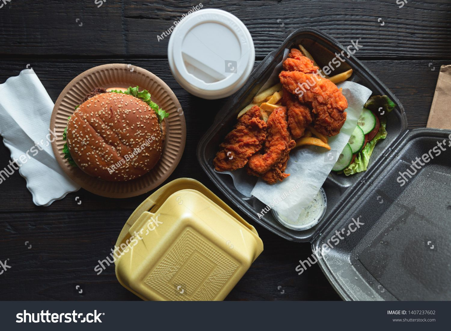 Hamburger, french fries and fried chicken in takeaway