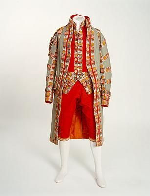 Footman's livery uniform, 1820. England. Servant uniform of a coat of light blue-green cloth, trimmed in red cloth and wool braid.  This was the livery of the 3rd Earl of Ashburnham, Sussex.