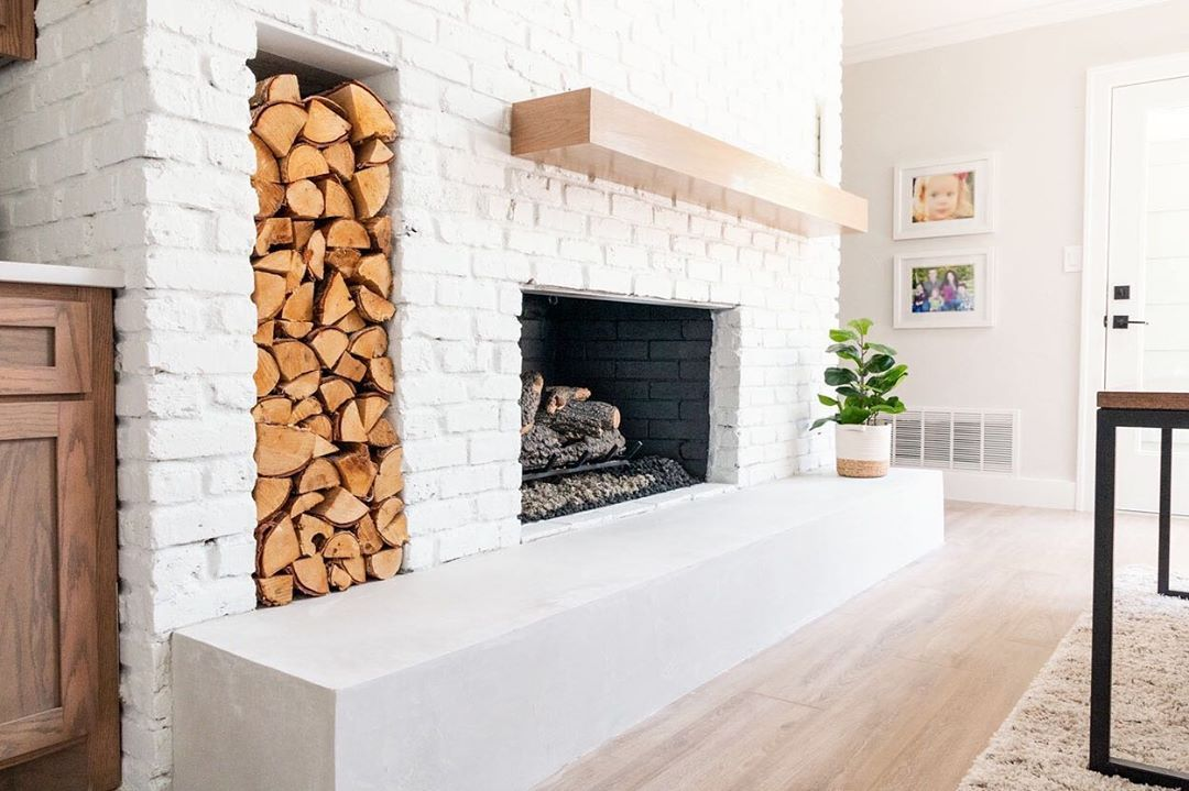 White Brick Fireplace With Firewood Stack White Brick Fireplace Red Brick Fireplaces Brick Fireplace Makeover
