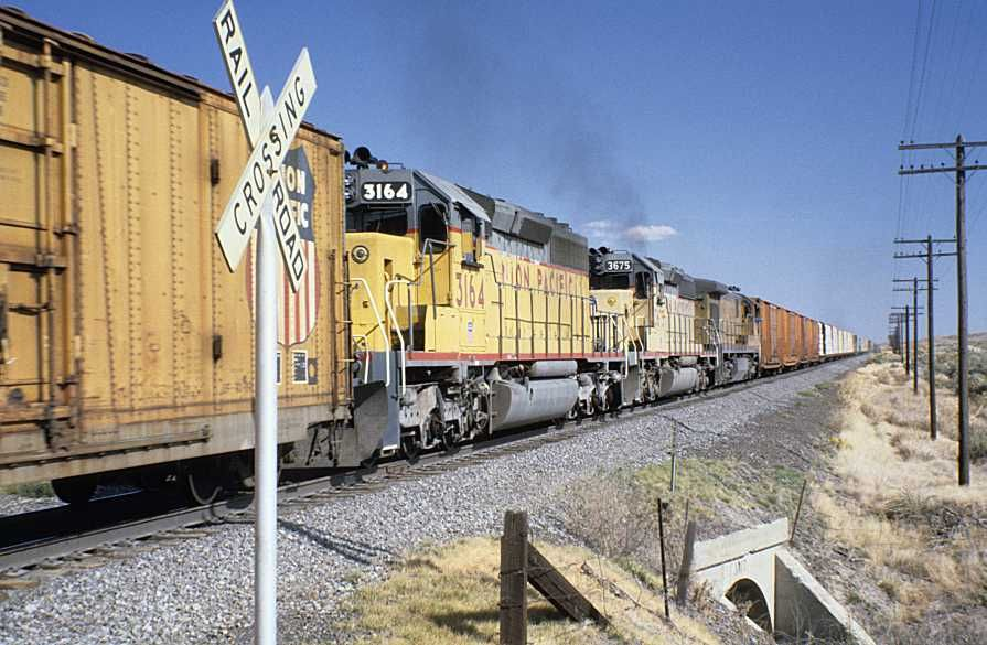 Union Pacific Mid Train Helper Engines On Freight Train Symbol
