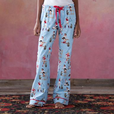 RETRO COWGIRL PAJAMAS--Classic cotton flannel (nothing's cozier!) in a cool retro print featuring pinup cowgirls. Red piping on collar, sleeve and pant cuffs. Three-button jacket with double pockets