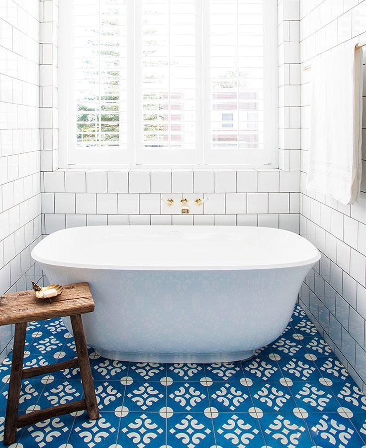 Beautiful tiles complement the amiata freestanding bath