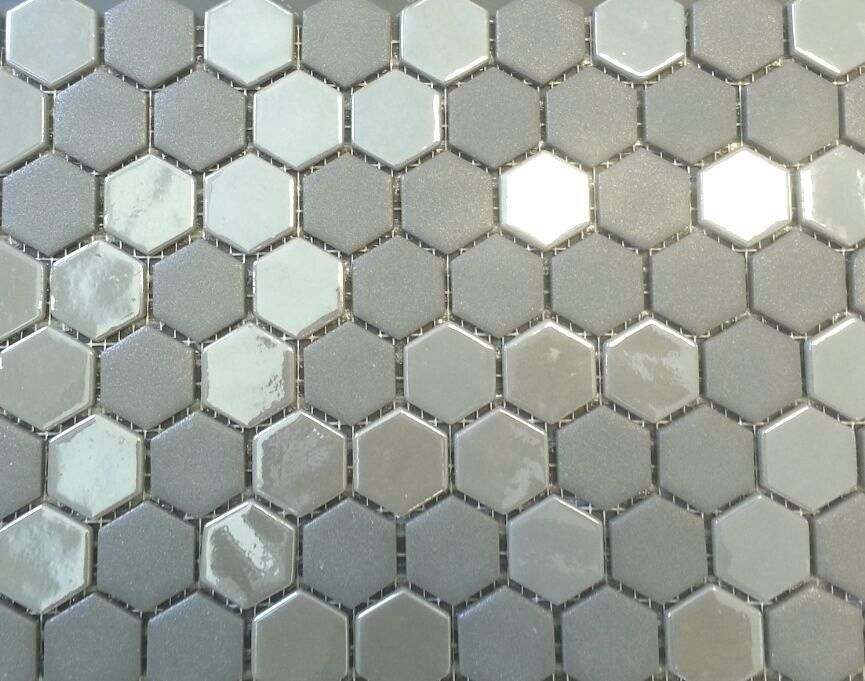 The shimmering opal effect of this stone glass hexagon mosaic adds drama & shine to any wall (Photo: Celebre Tile) #TileTuesday #opal #hexagon #glass #stone #mosaic #walls #kitchens #backsplash #bathrooms #showers #tilestyle #tileaddiction #tiles #installation #residential #commercial #custom #design #getinspired #gettiled #CelebreTile #tileprofessionals #21royalcrestrd #etobicoke by celebretile