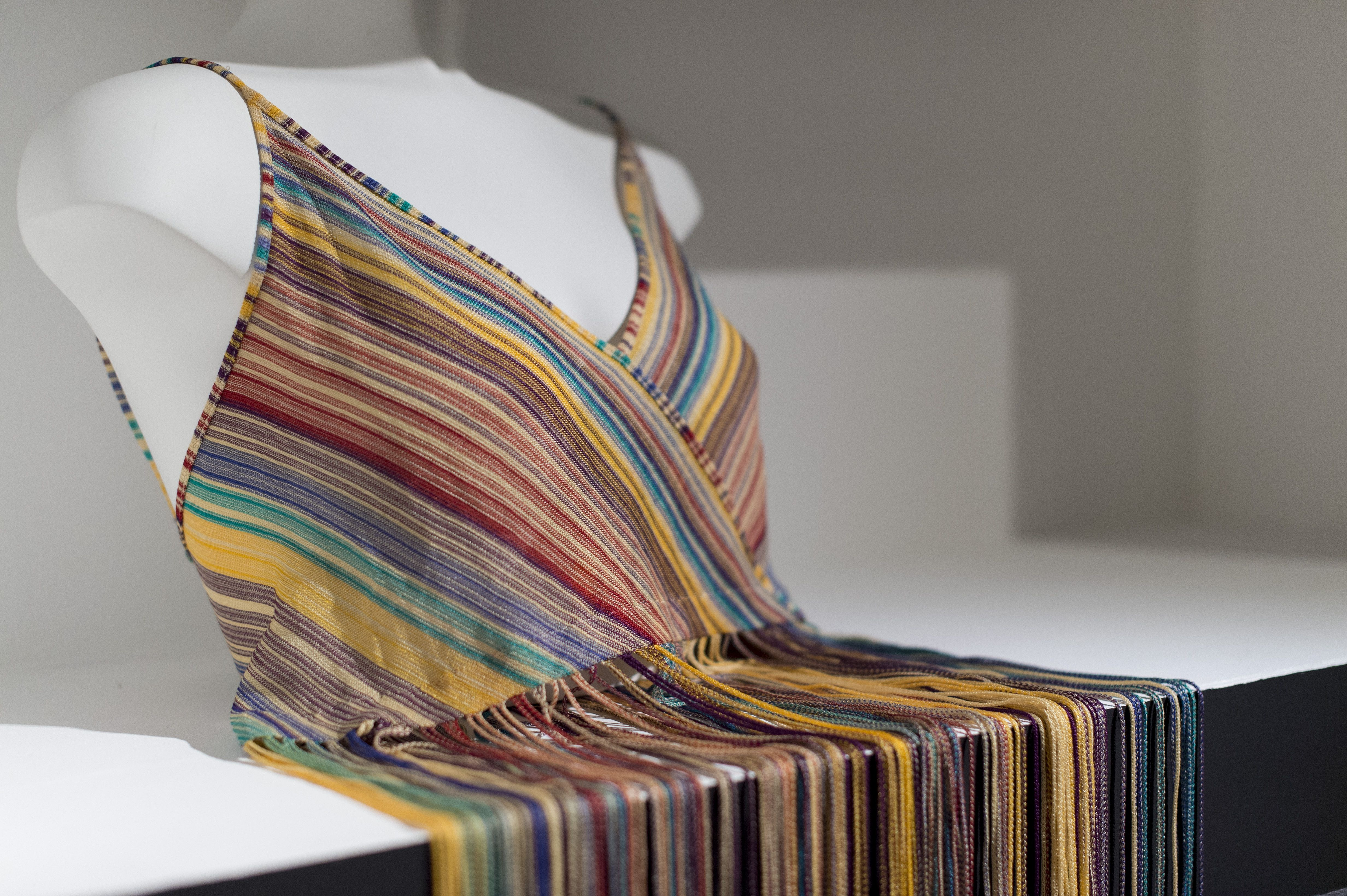 Vest Missoni, C 1970s, Rayon This fine knit, fringed vest is typical of the Missoni style. Their use of space dyed machine knits was copied by knitwear manufacturers around the world.