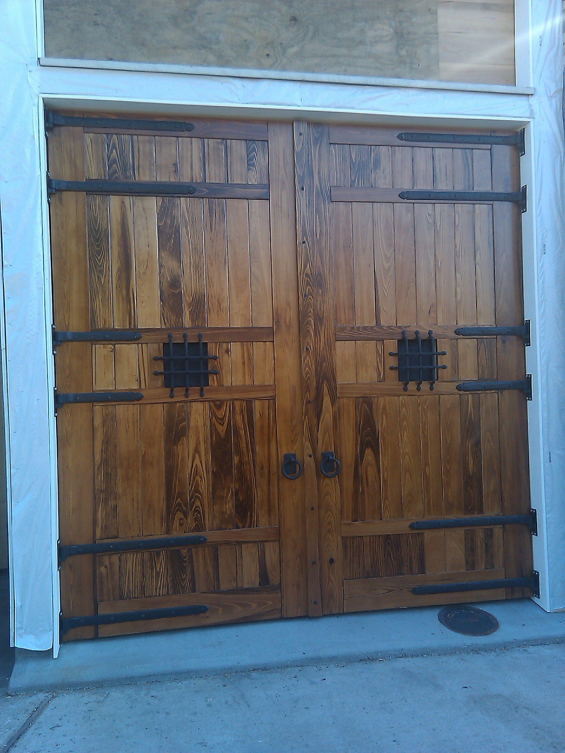 New Orleans Historic Carriage House Doors With Bronze Door Hardware