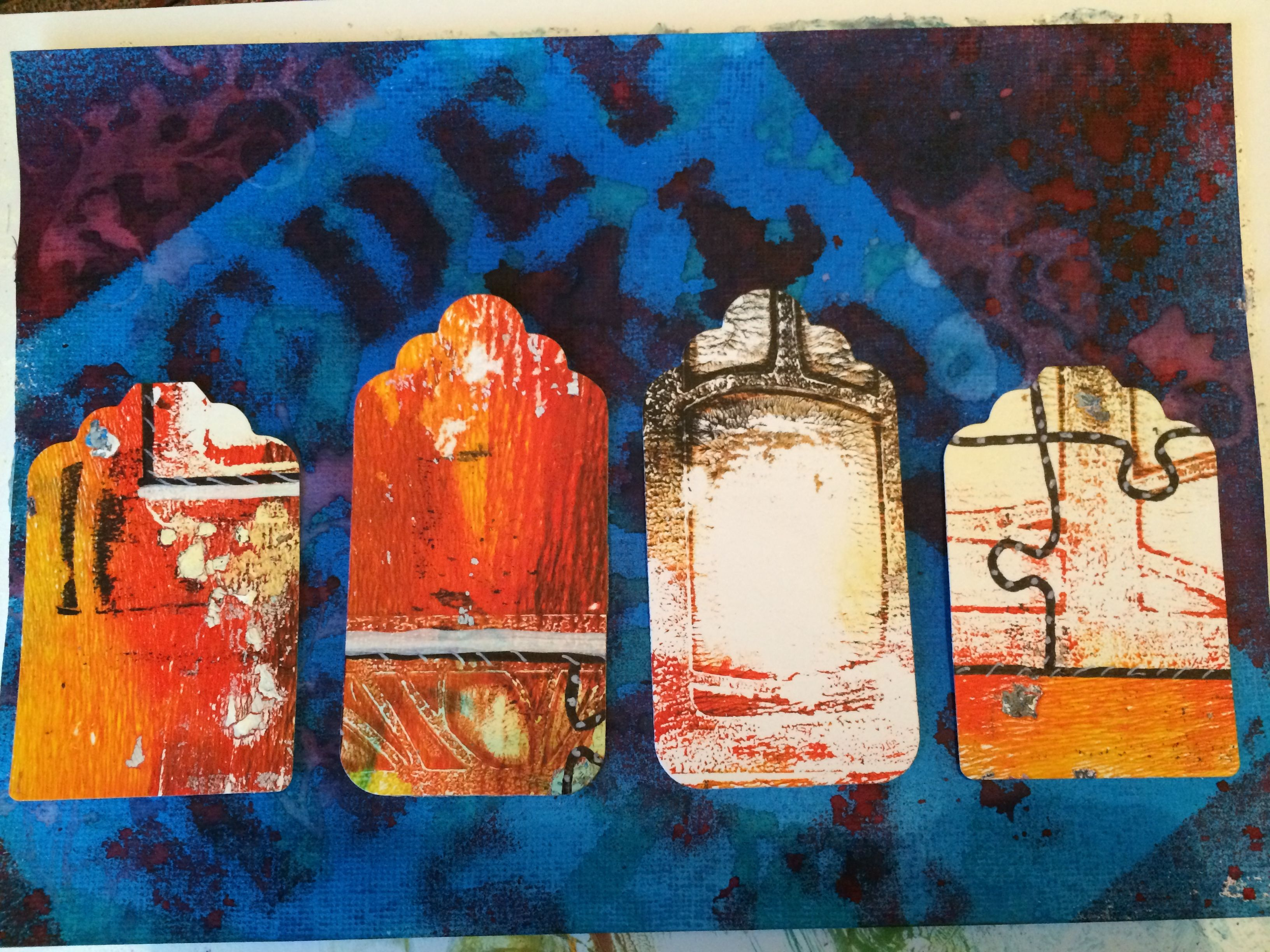 I made some old Gelli Plate prints into Tags. All Stencils used in this picture are by Clarity Stamp By Sam Crowe