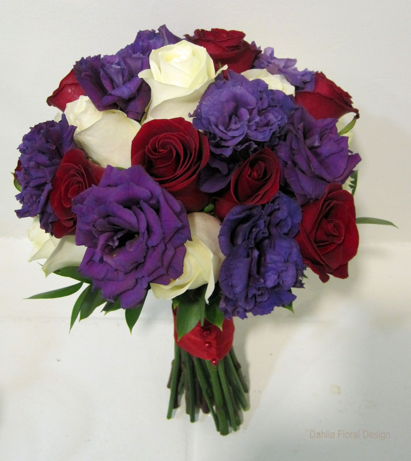 Rich Jewel Tones Of Red And Purple Are Accented With Ivory In This