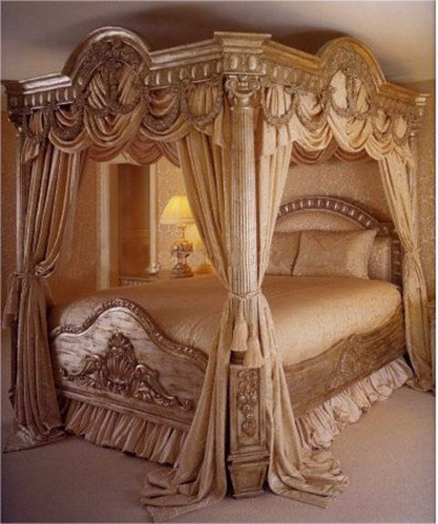 Antique canopy bed with gold