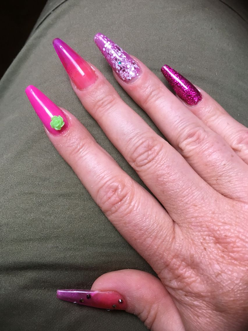 Pink and purple long Stiletto nails with glitter, rhinestones and ...