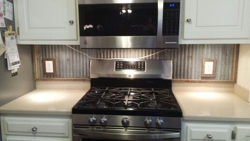 kitchen with metal backsplash tin from my barn used as a backsplash barnwood and 6531