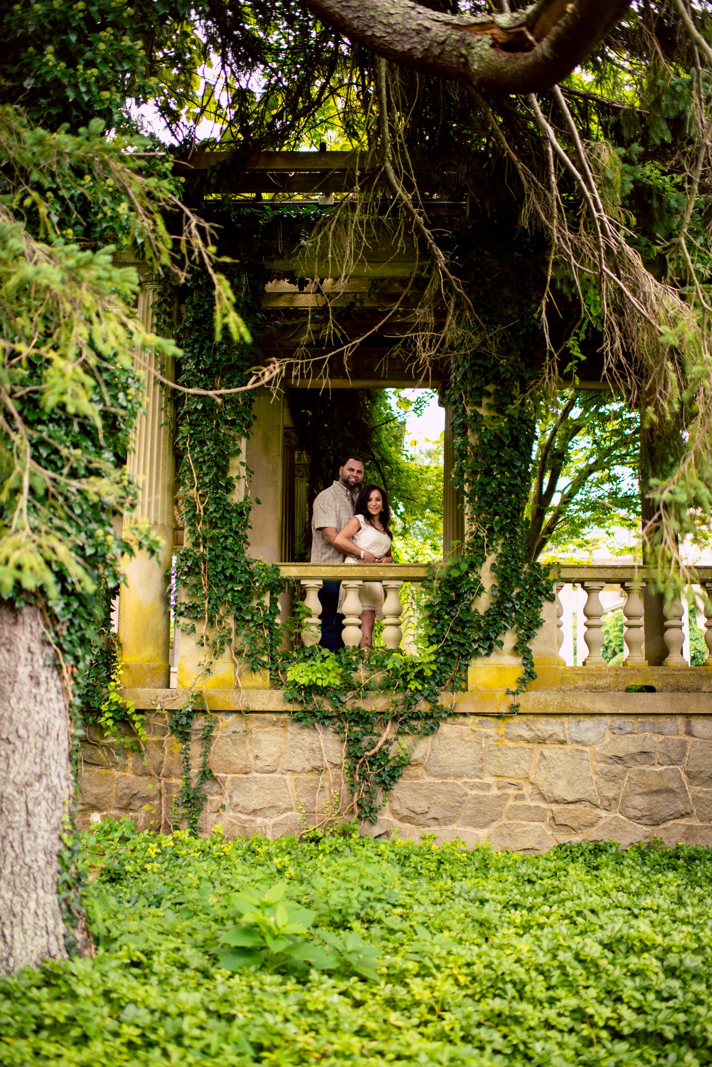 Another #tremendous, #romantic image of the #engagedcouple. We love the #rusticcharm + #ageold #romance of it all. ::Celina + Jonathan's stunning engagement session in New England:: #gazebo #vines #romanticimages #weddingphotography #photography