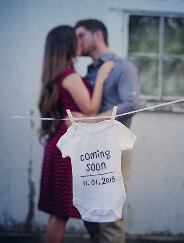 5c9cfedbf15f6 Parents blurry kissing in the background, Focus on baby onesie with due  date.