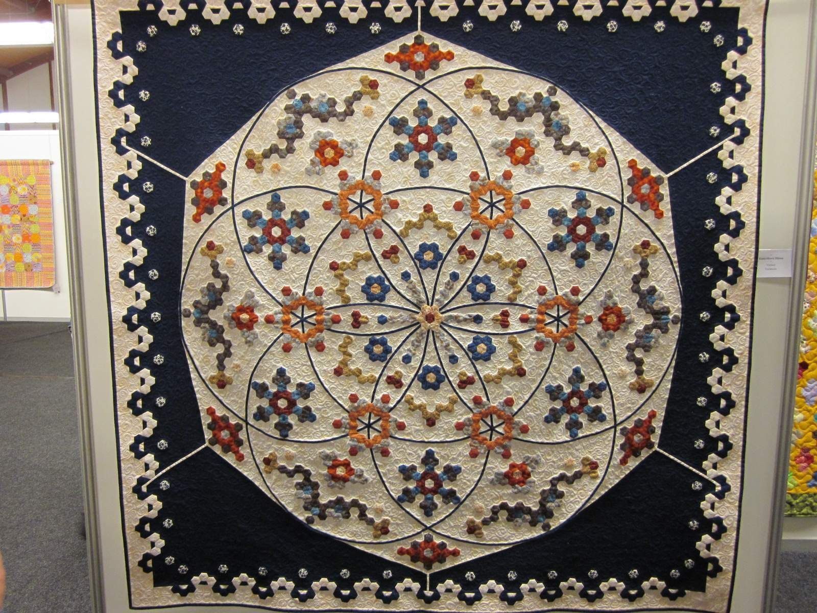 klikni pro další 53/168.  Motifs, including the borders, must be appliqued onto background because some hexagons are vertical (pointing up/down) and some are horizontal (pointing to right/left).  For example, look at the borders.