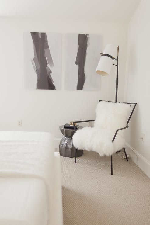 Attractive Black And White Bedroom Reading Corner Is Filled With A Black Chair Lined  With Sheepskin Next