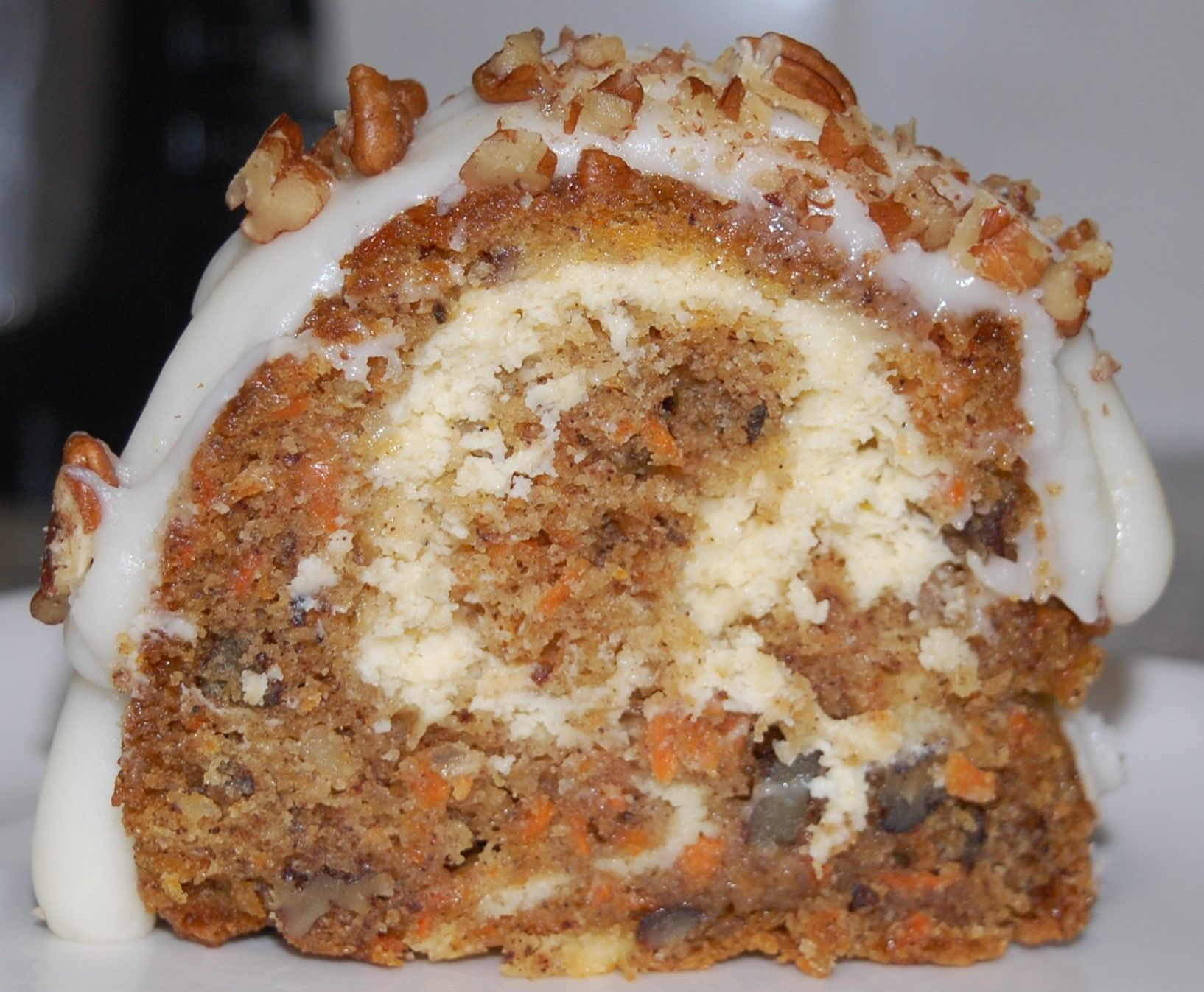 Carrot bundt cake with cheesecake filling and cream cheese