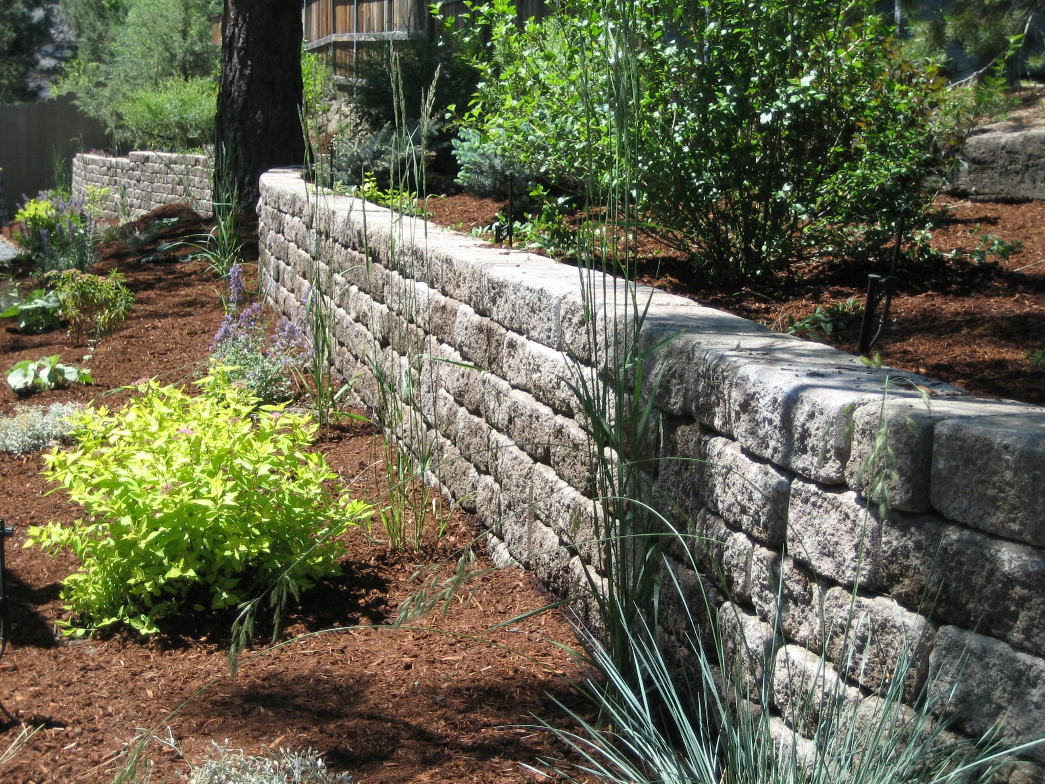 Retaining wall roman stack stone mutual materials for Rock wall garden
