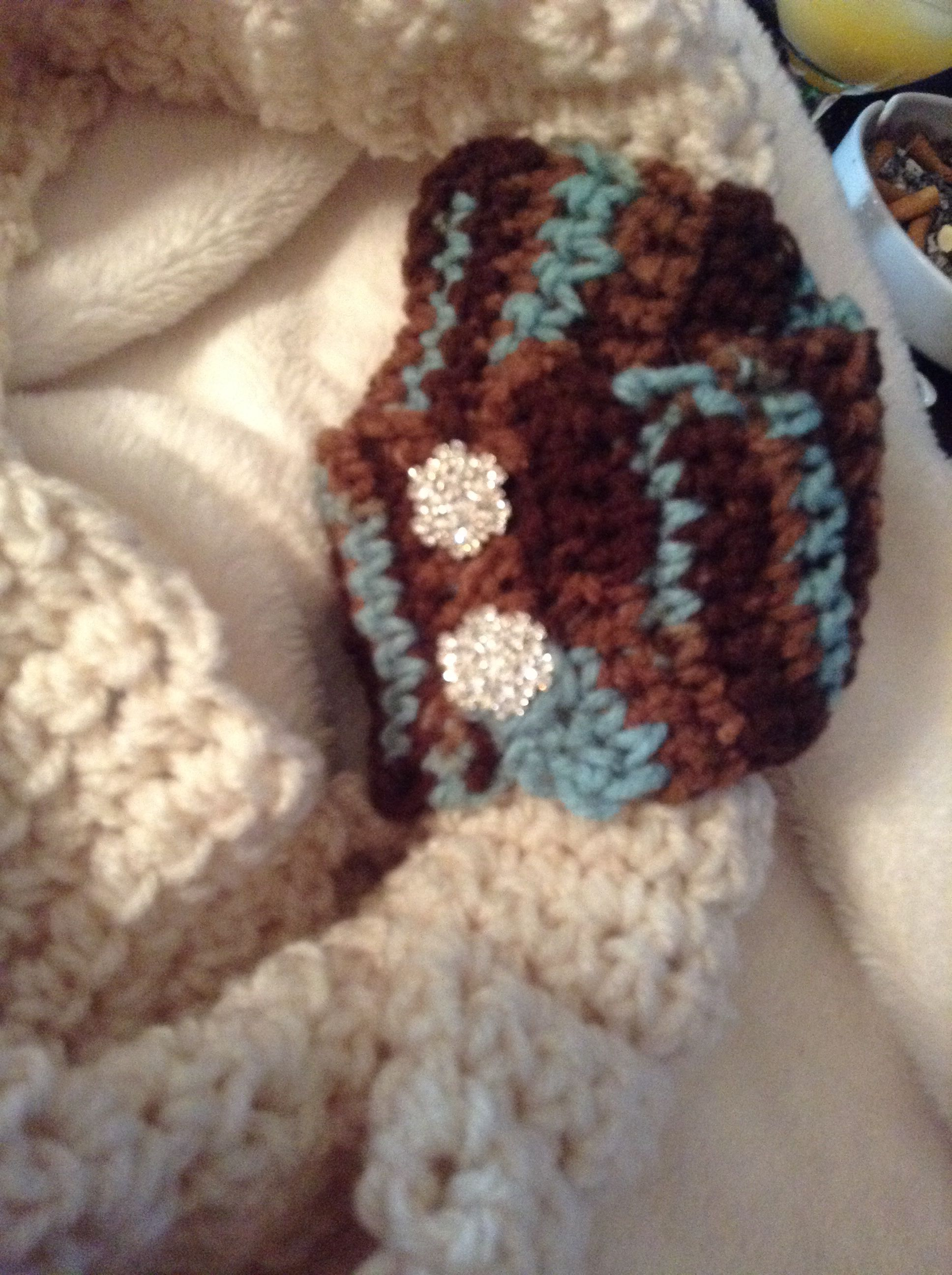 Bling bling buttons tie this blue and brown strap in to the cream infinity scarf! Jazz up an everyday scarf!