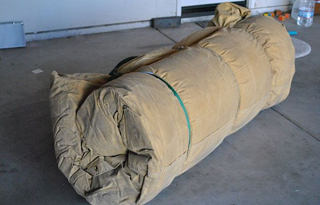 How to Make A Cowboy Bed Roll | Comfortable Camping Tips | The basic idea of a cowboy roll is a sleeping pad and a sleeping bag all rolled up in a big piece of canvas. | survivallife.com