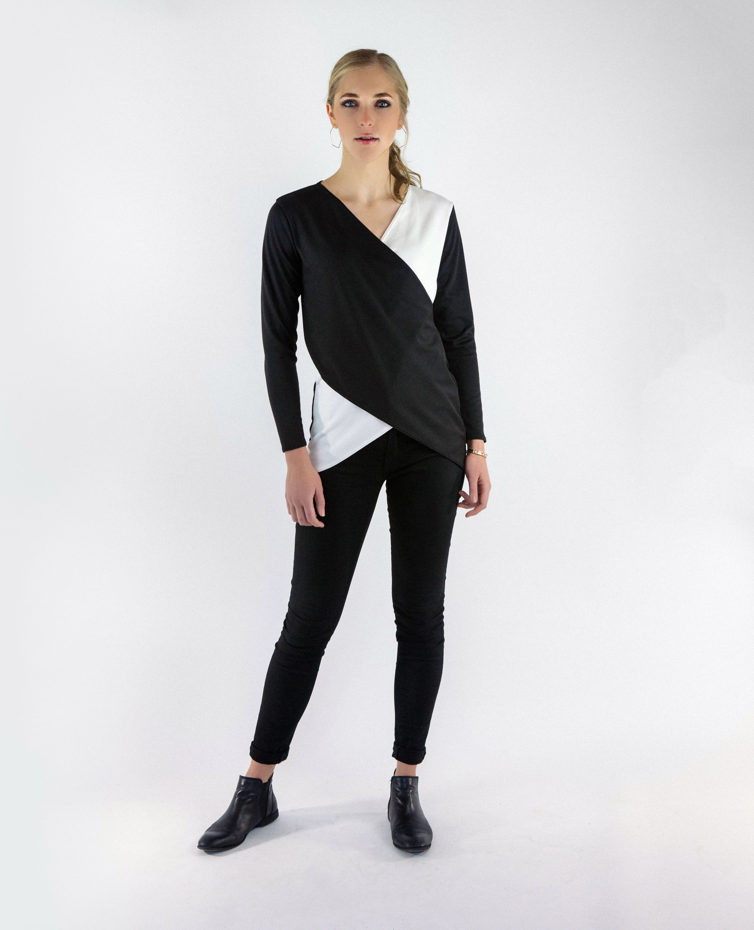 """Criss-crossed front panels in a comfy stretch knit create thismodern tunic  top.Pairs perfectly with your favorite leggings or jeans, or dress it up  for a night out. Get thissophisticated look with Machine's signature  edge.      * Rayon/Nylon/Spandex blend.     * Machine wash cold,gentle cycle.Tumble dry low or lay flat to dry.     * Model is 5'9"""" and wearing a small.     * Made in Portland, Oregon.  View size chart."""