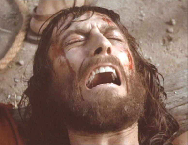 Jesus (Robert Powell) being nailed to the Cross