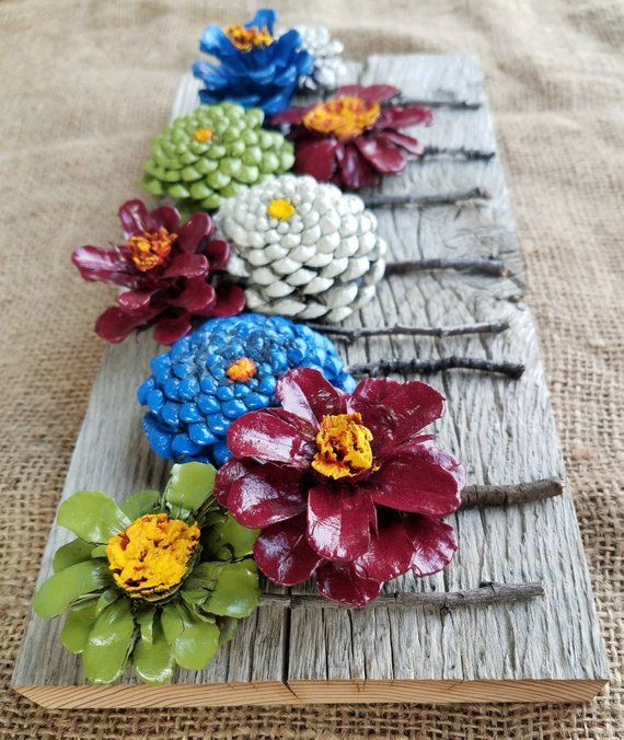 Hand painted pincone flowers on reclaimed barn wood #creativeartsfor2-3yearolds