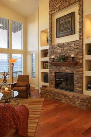 Tall stone fireplace refinish idea for the white brick - Floor to ceiling brick fireplace makeover ...