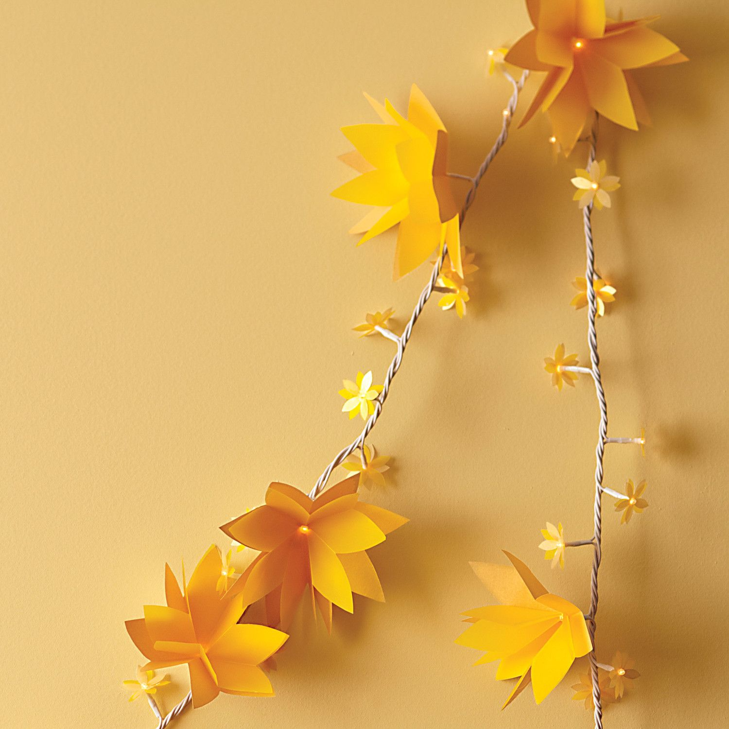 Light up paper flower garland how to vellum paper flower lights dress up a serving table or add some sparkle to a photo booth with these easy to make paper flower lights to add drama use a bright bold shade of vellum mightylinksfo
