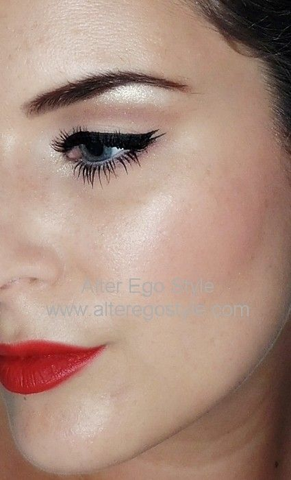 A variation of bright matte red lips with black double ended eyeliner, a touch of shimmer under brows and inner corners of the eyes.