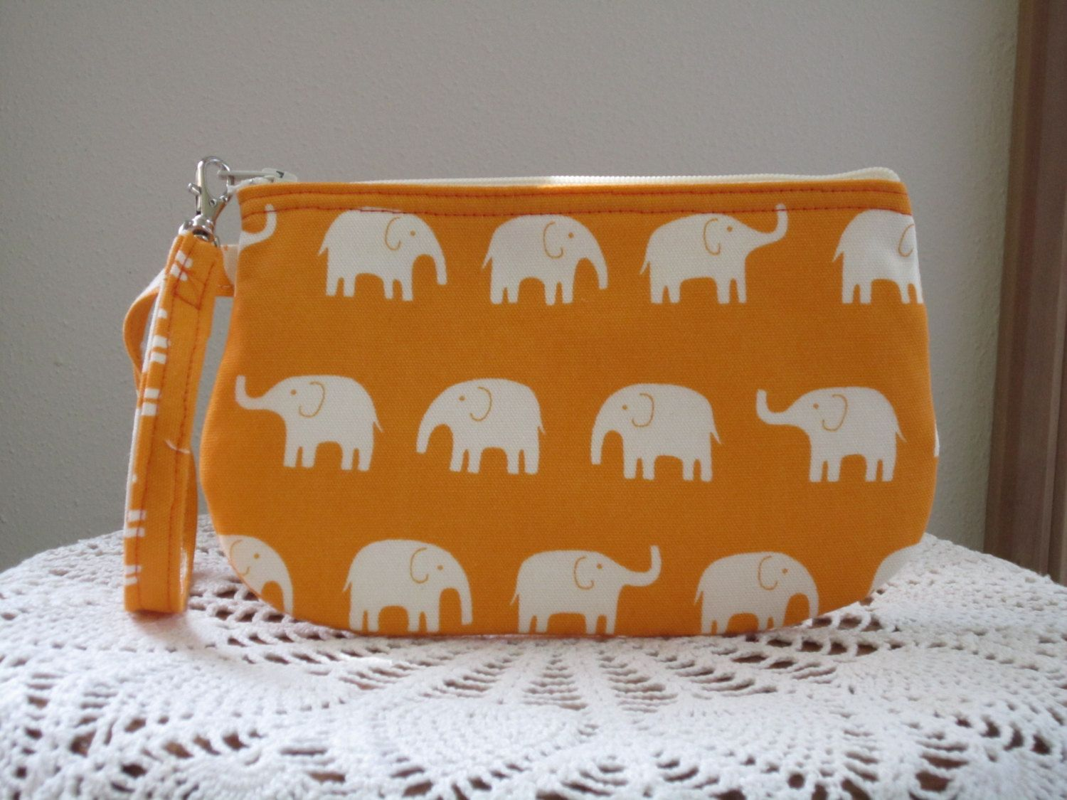 Clutch Wristlet Zipper Gadget Pouch White Elephants on Parade Orange - pinned by pin4etsy.com