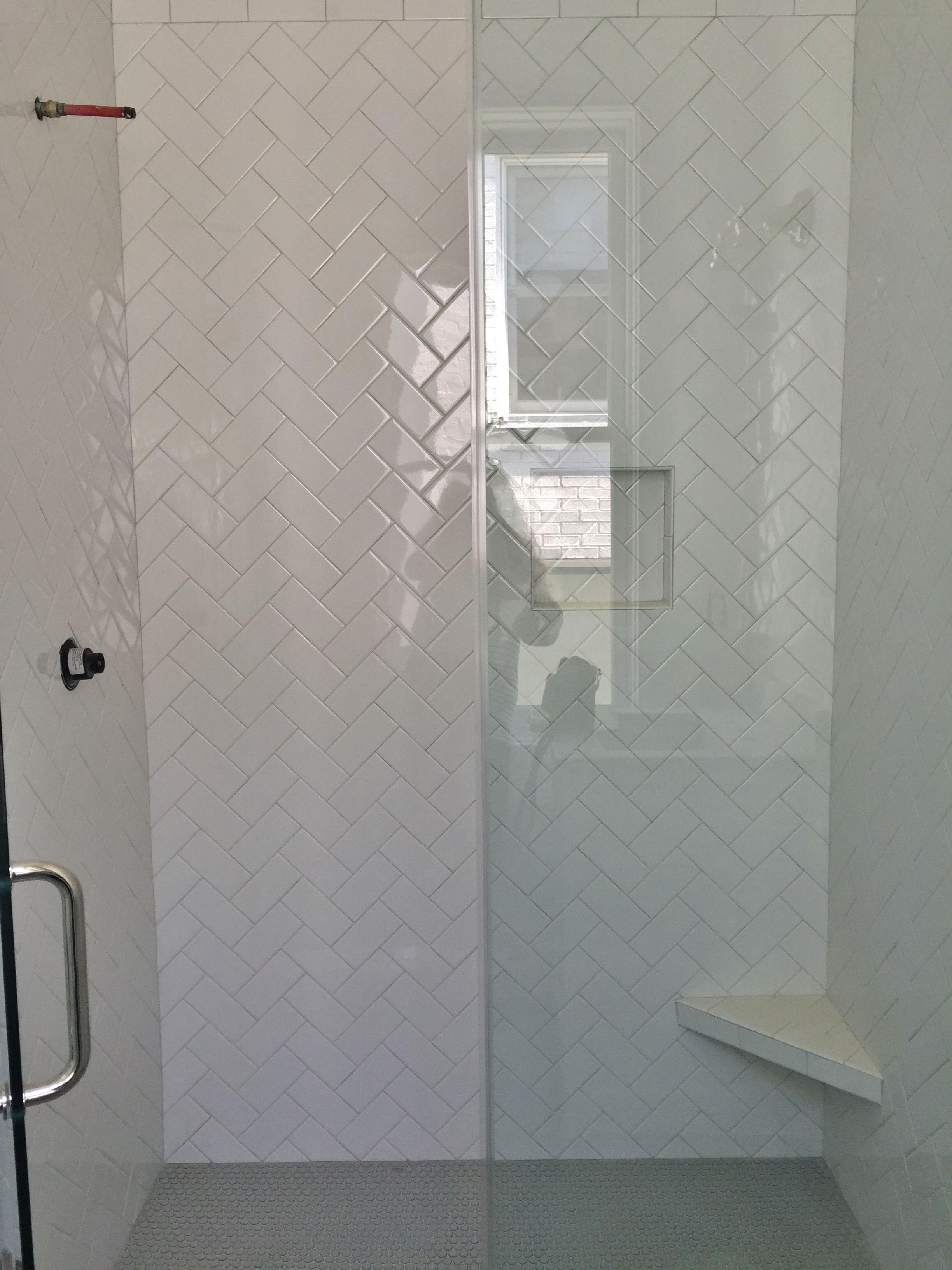 3x6 White Subway Tile Set In Herringbone Pattern Gray Penny Rounds On Floor Herringbone Tile Bathroom Shower Tile Designs Shower Tile