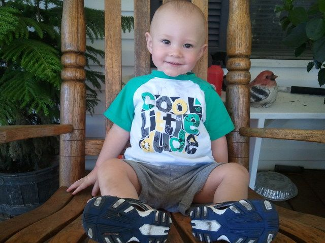 Taking a picture of Tripp in Grandma Jo's rocking chair... Need to print and frame this for her.