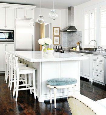 love the marble backsplash & small blue velvet stool