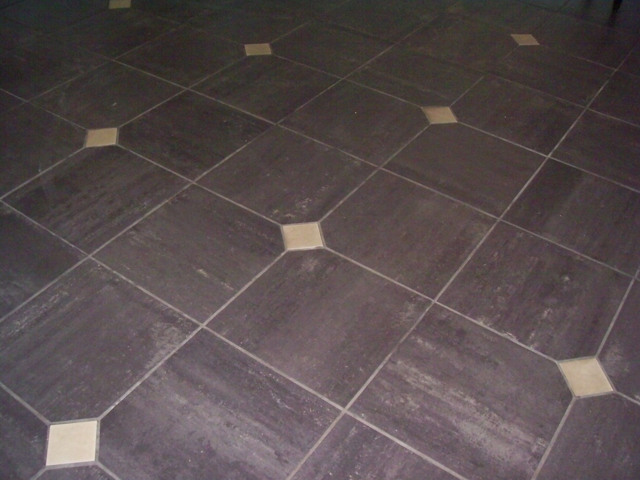 Which Types Of Flooring Cost Less And Which Types Cost Less Ceramic Tiles Porcelain Tile Shower Tile Designs