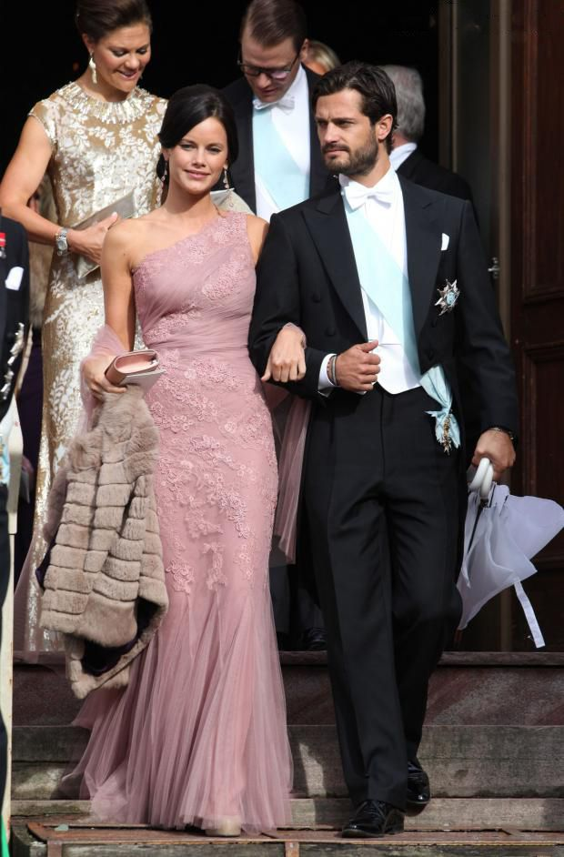 Swedish Prince Carl Philip with his girl friend Sofia Hellqvist attends the wedding of Gustaf Magnuson (son of the sister of King Carl XVI Gustaf of Sweden) and Vicky Andren at Ulriksdals in Stockholm Castle, 31 Aug 2013