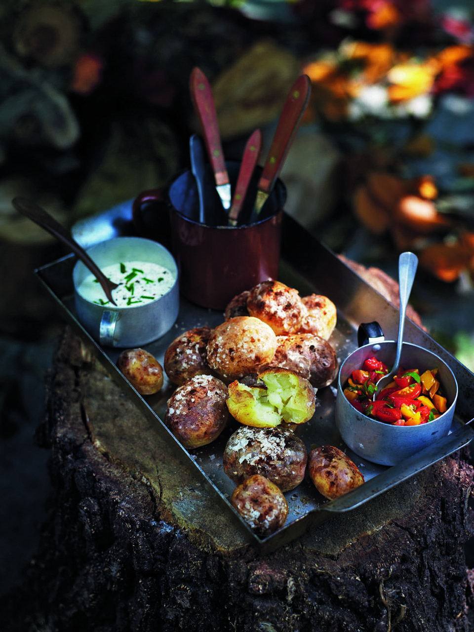 Fire-baked potatoes with soured cream and fiery salsa recipe | delicious. magazine