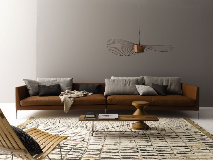 Modern Chic With Earthy Colours And An Expansive Cognac Coloured Leather Sofa Sofa Pilotis Cor De Rug Be 1593 Rugstar Com In 2020 Diy Living Room Decor Brown Couch Living