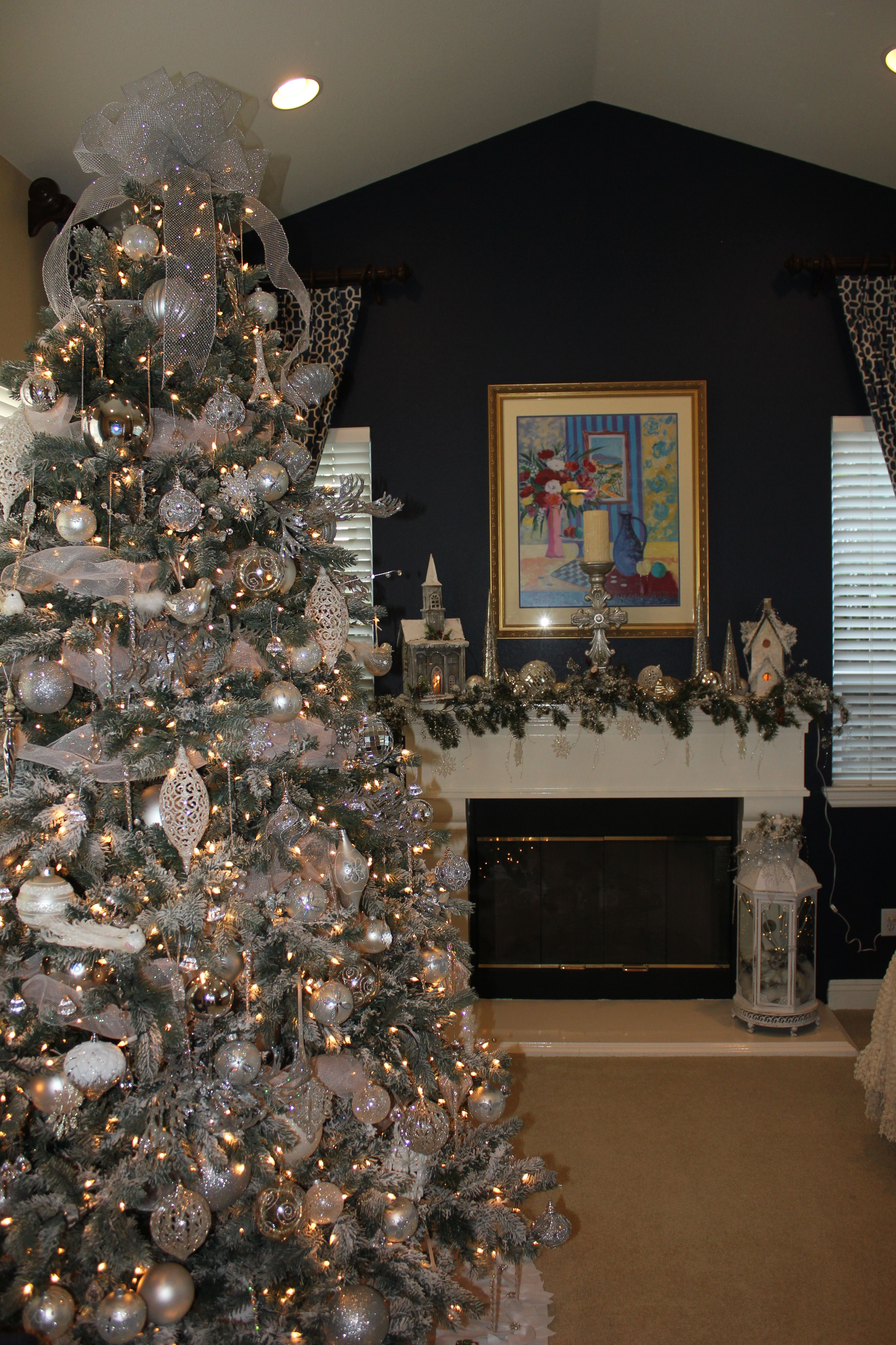 Silver And White Christmas Tree With Beautiful Navy Blue Wall And