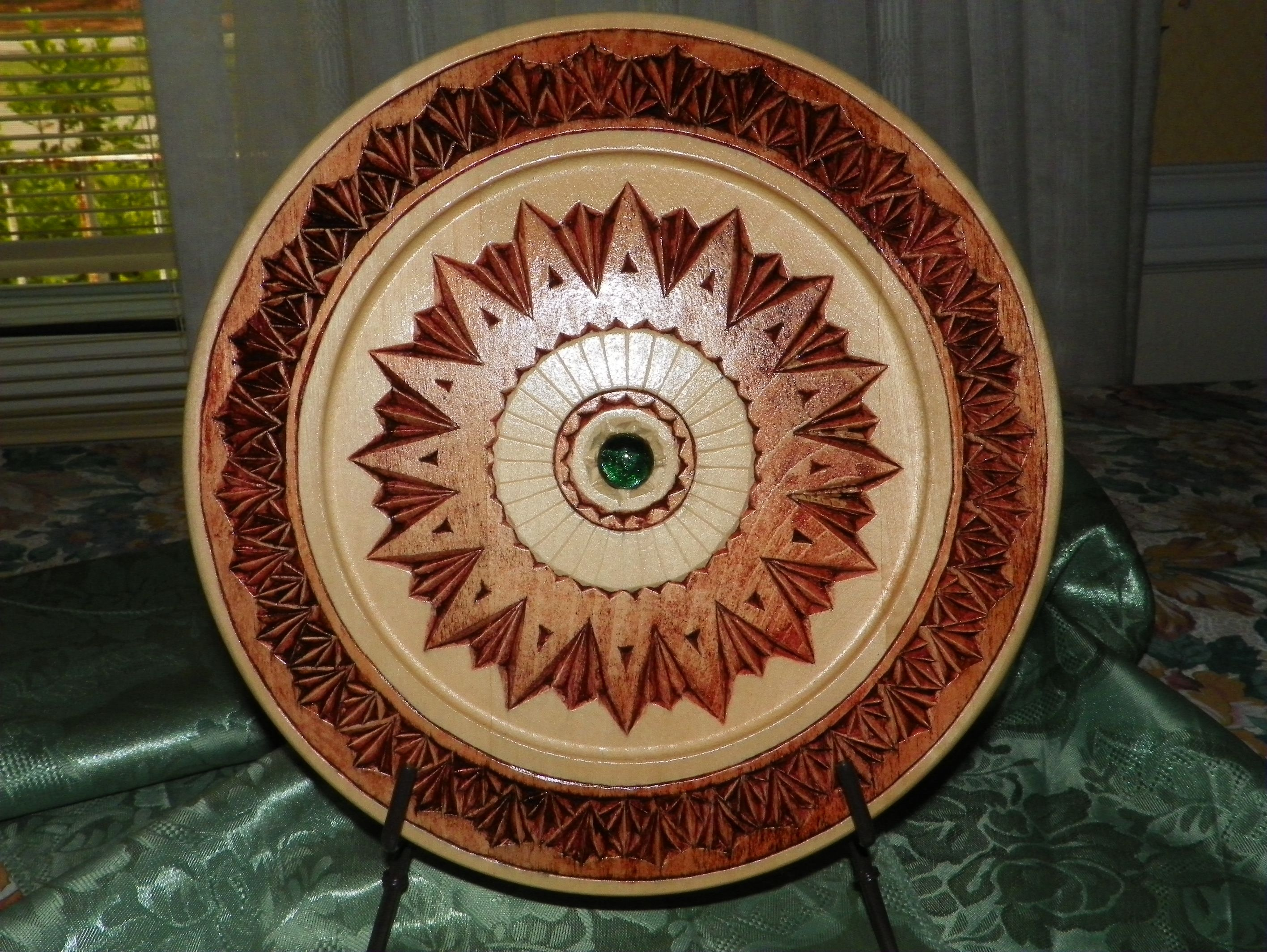 "Chip carved 10"" basswood plate with diachronic bead center and staining. $45"