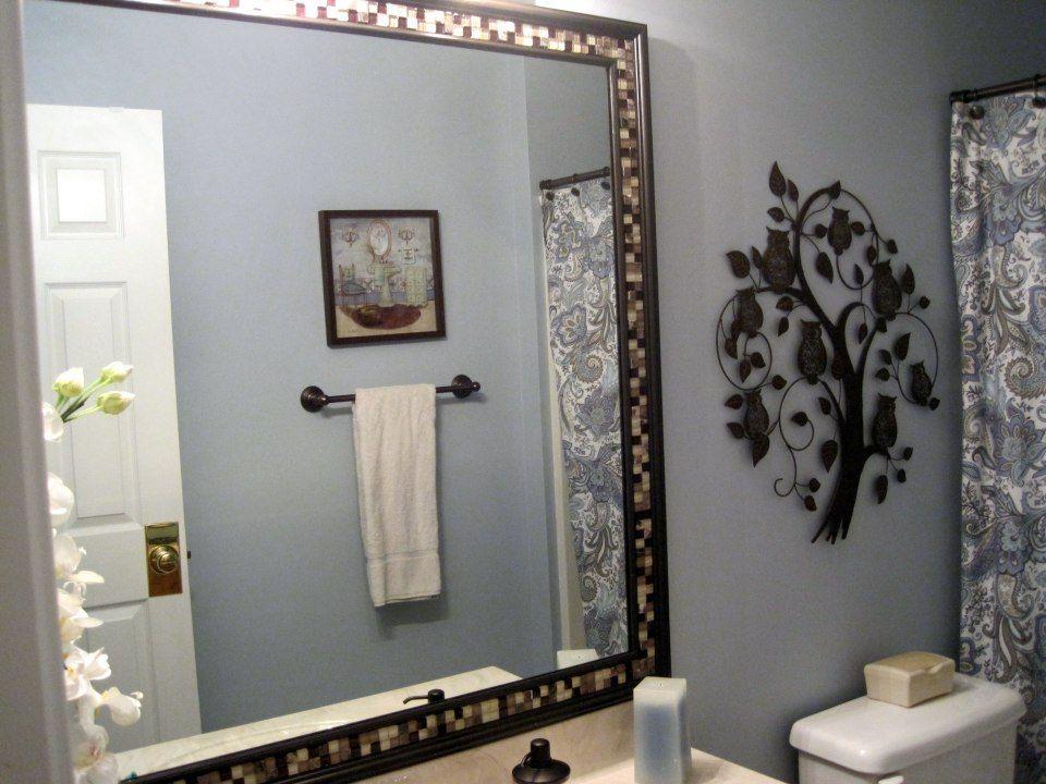 06425ff925f How to frame a bathroom mirror already mounted on the wall. This is so  pretty. I think I ll try it.