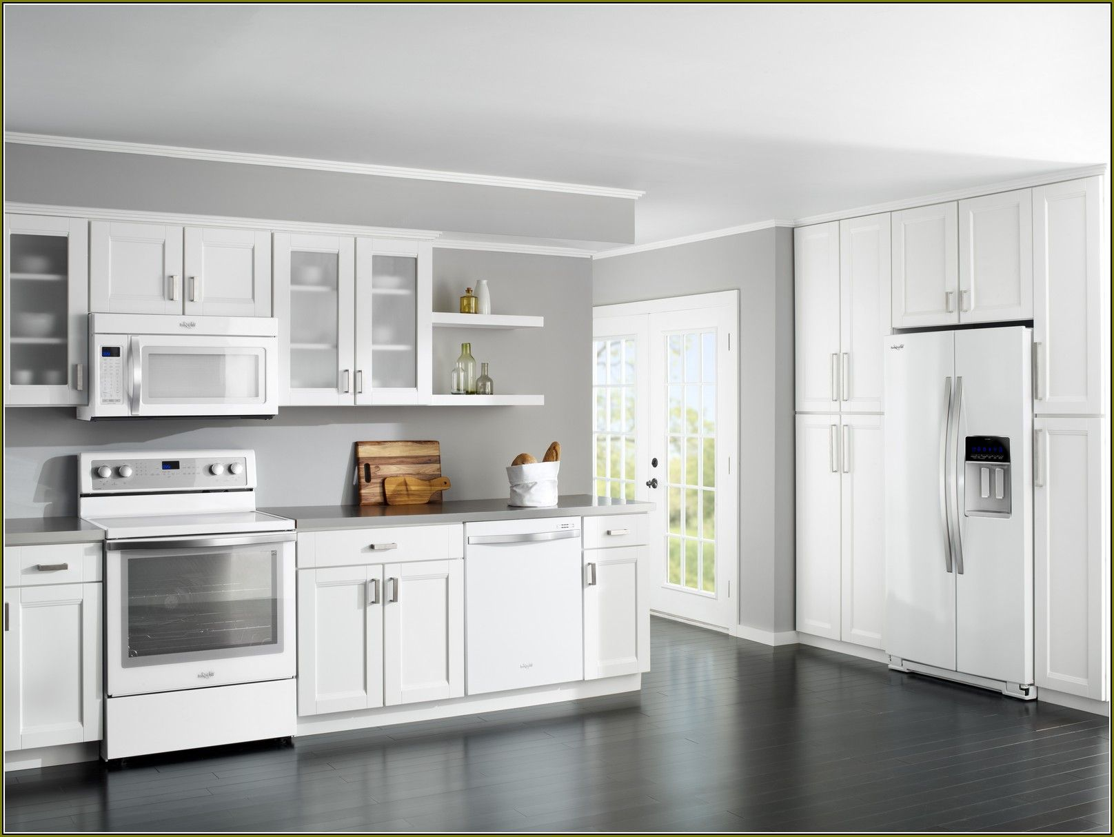 cream colored kitchen cabinets with white appliances | home