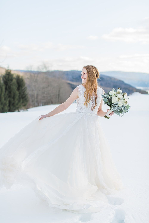 Winter wonderland wedding dress  Winter Wonderland Wedding Group Photo Shoot  Snowy Outdoors Wedding