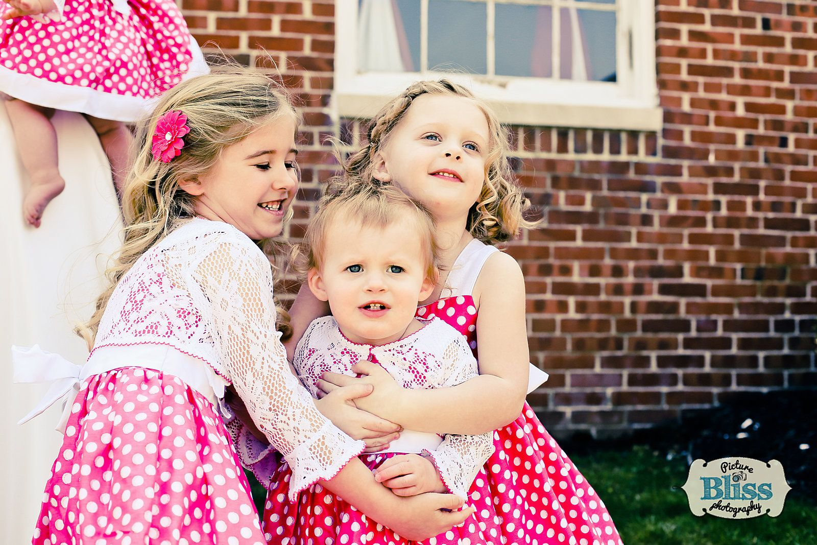 Flower girls in polka dot dresses, vintage style, adorable