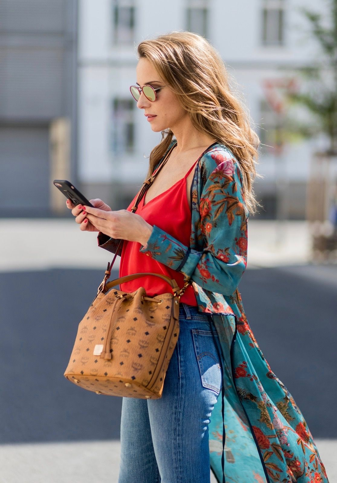 461a28bc Model and fashion blogger Alexandra Lapp wearing a wrap dress in Kimono  style from Zara, silk tank top from Jadicted, petite bucket bag from MCM,  ...