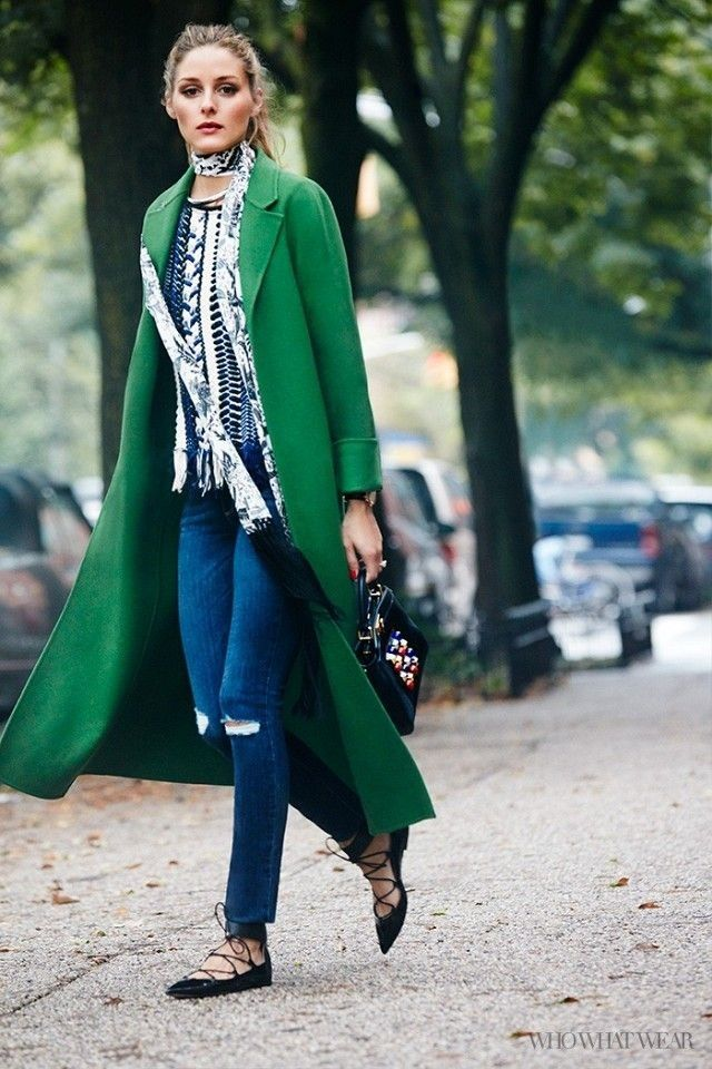 Olivia Palermo wears a green coat with a printed blouse, a skinny scarf, jeans, lace-up flats and a beaded handbag. #olivia
