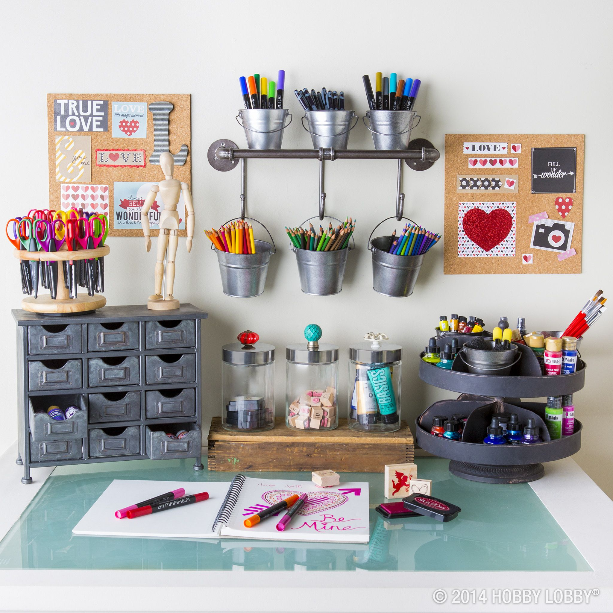 If art supplies have taken over your desk, clean it up