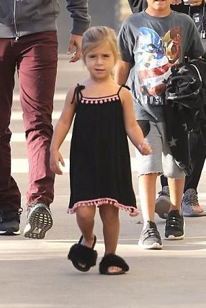 74e08871e Penelope Disick wearing Akid Aston Sandals in Black and Misa Los Angeles  Pompom Pia Dress