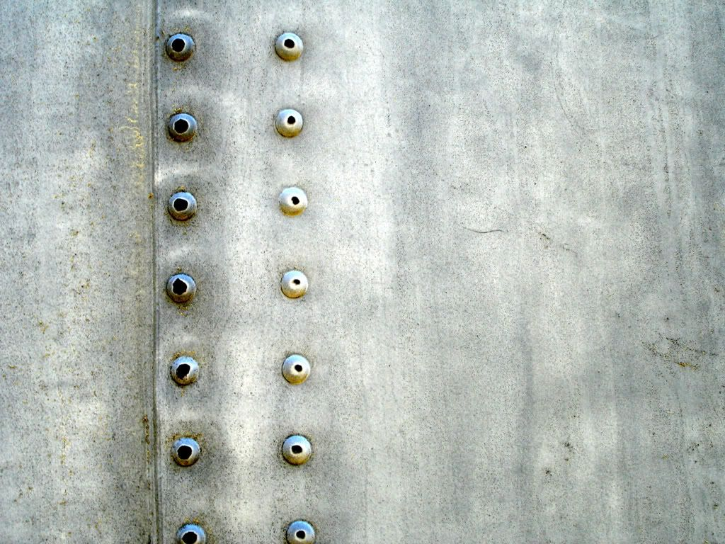 Closeup of rivets on an antique airplane  | Design Inspiration in
