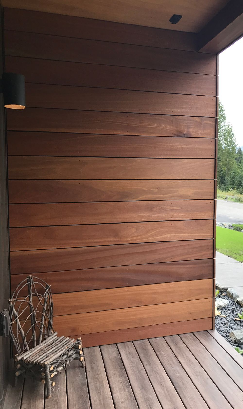 Beautiful Batu Mahogany Hardwood Siding On This Home Carries Into The Front Porch Natural Wood Siding In 2020 Wood Siding Exterior House Exterior Exterior Wood Stain