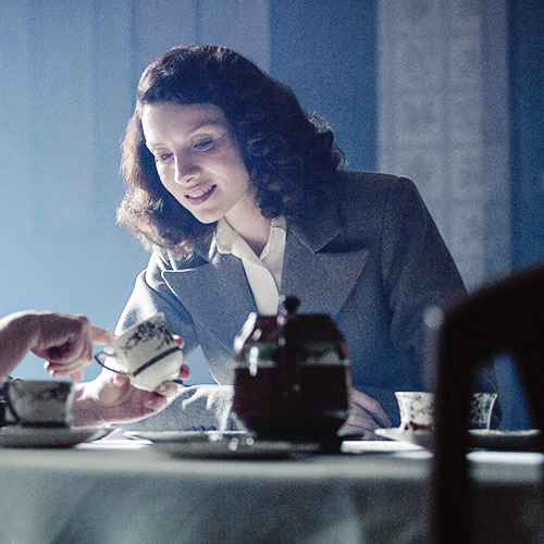 Claire getting tea leaves read. (Outlander)